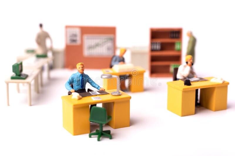 Miniature puppet business people at the office stock photography