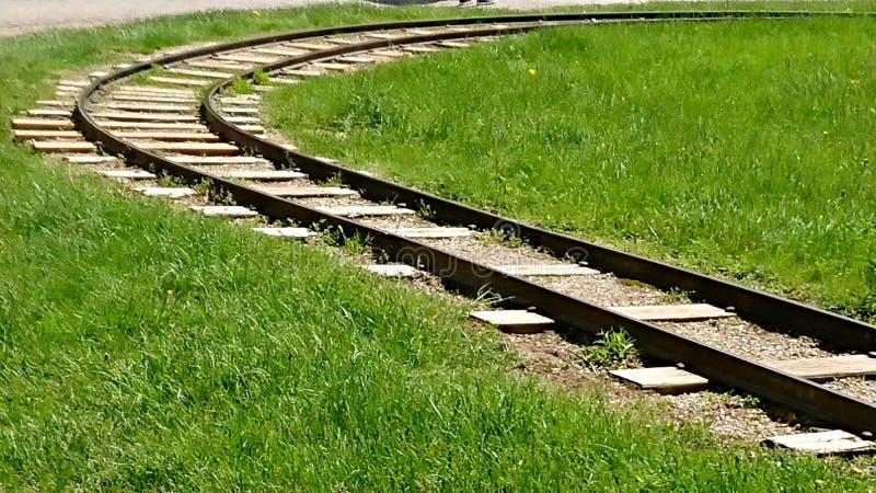 Miniature railroad tracks riverside park Guelph Ontario canada. Miniature railroad tracks riverside park Guelph Ontario, kid, amusements, along, speed, rsiling stock image