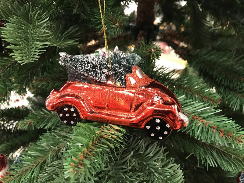 MINIATURE RED CAR WITH FIR TREE CHRISTMAS TOY. HOLIDAY THEME stock image
