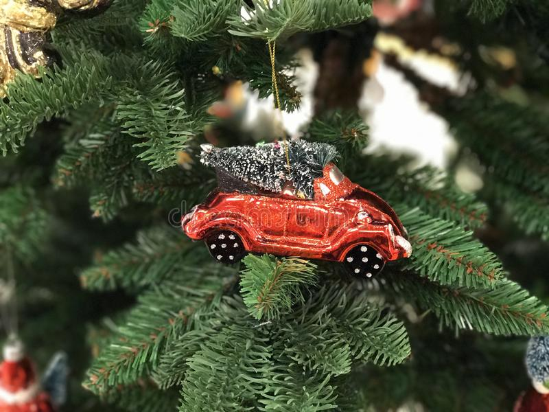 MINIATURE RED CAR WITH FIR TREE CHRISTMAS TOY. HOLIDAY THEME stock photos