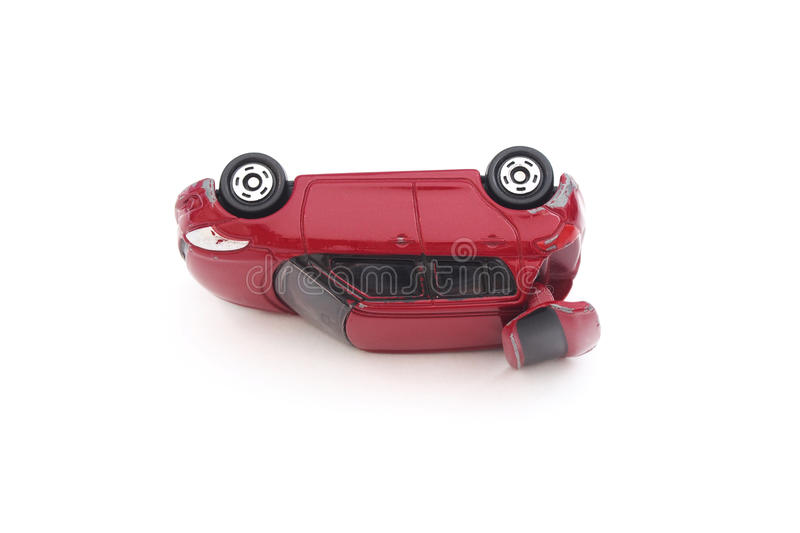 Miniature red toy car in accident stock photos