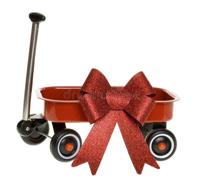 Miniature red Wagon with Glittery Christmas Bow stock photo