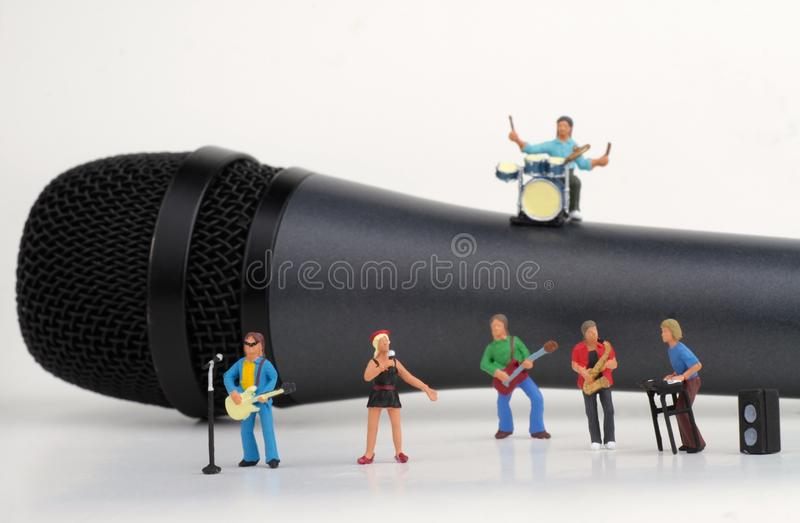 Miniature of a rock band. Performing on a microphone royalty free stock images