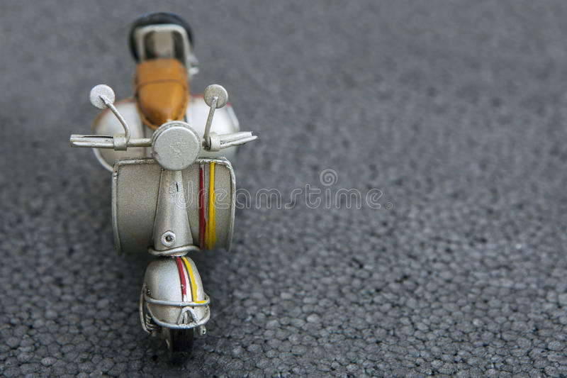 Miniature scooter motorcycle. One miniature scooter motorcycle on a road stock photo