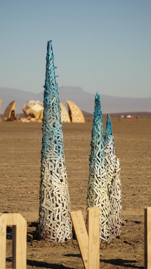 Miniature sculptures of AfrikaBurn wooden structures in the Karoo desert of Tankwa Karoo National Park in South Africa.  royalty free stock images
