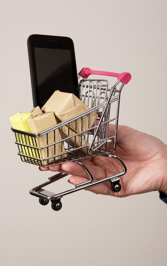 Miniature shopping trolley parcels and mobile phone stock images