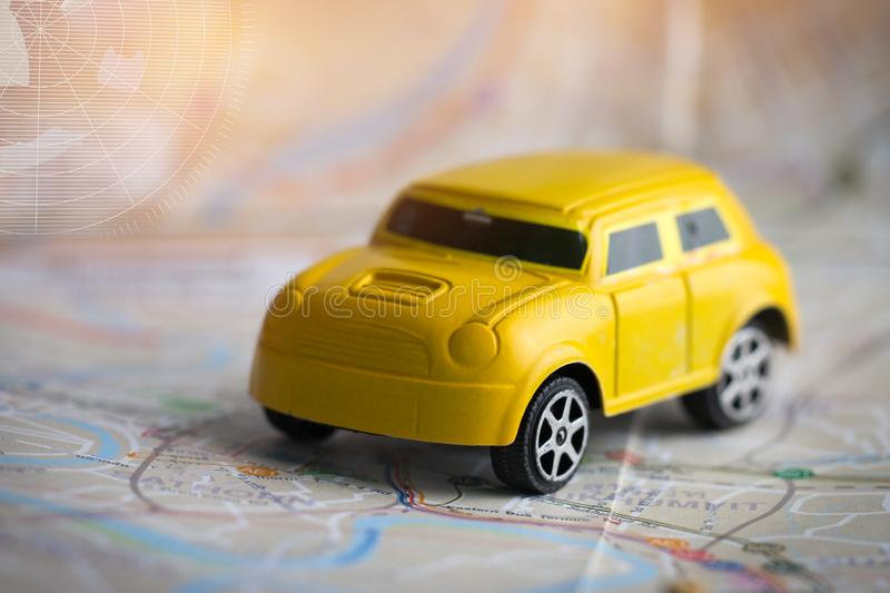 Miniature or small Yellow Car with GPS on Bangkok city map, Concept for travel around direction to destination. Adventure begins. Right now, Travel Concept royalty free stock photo