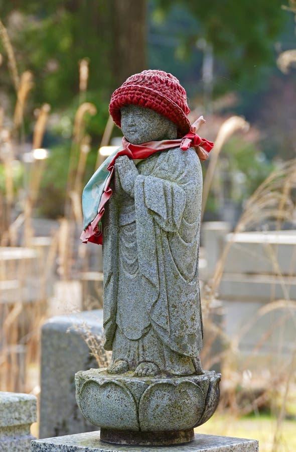 Miniature Standing Buddha Statue inside Okunoin Cemetery in Wakayama, Japan. Miniature Standing Buddha Statue inside Okunoin Cemetery royalty free stock photo