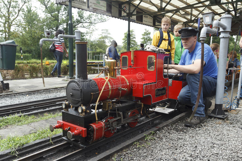Miniature Steam Train. Steam miniature train driver preparing the locomotive for an imminent departure royalty free stock photos