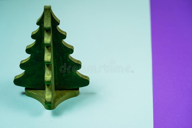 Miniature toy Christmas tree on a wooden table. Imitation realistic scene. royalty free stock images