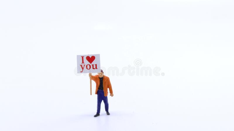 Minature with I love you sign royalty free stock image