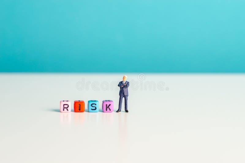 Miniature toys - risk concept. Of risk taker, financial risk, etc stock photo