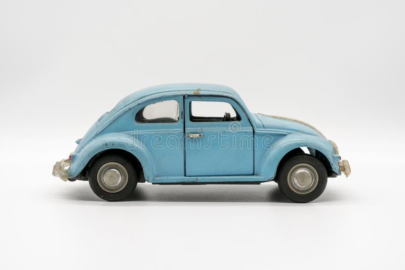 Miniature vintage dirty car. Isolated on white background royalty free stock image