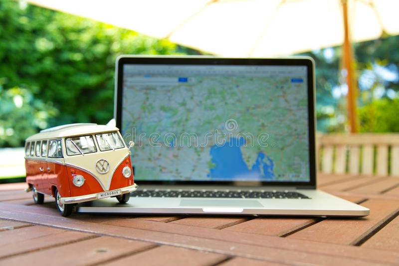 Miniature VW Bulli 1962 on laptop. royalty free stock image