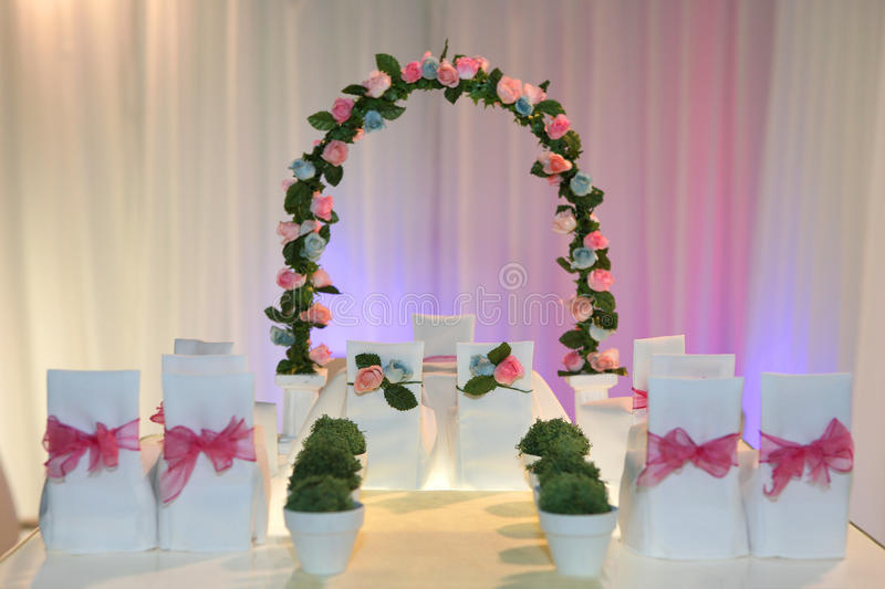 Miniature wedding scene. With arch made of roses, shallow dof royalty free stock photo