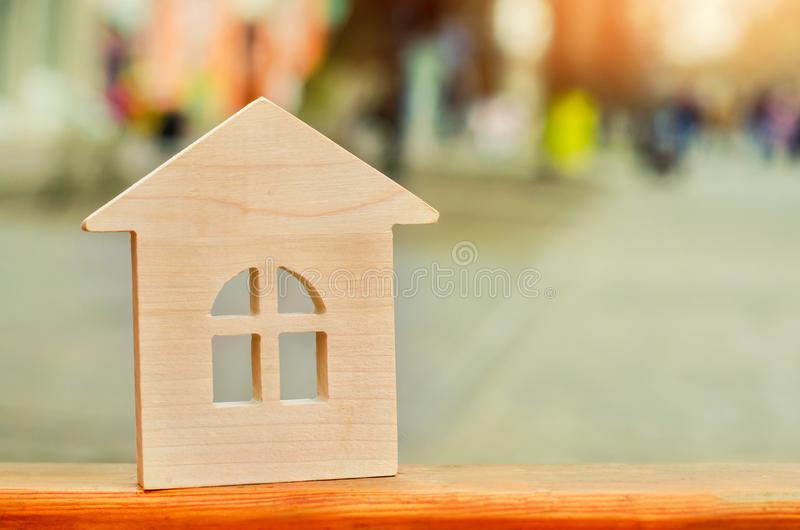miniature wooden house. concept of real estate. sale of apartments. purchase of housing. apartments for rent. place for text. New stock photo