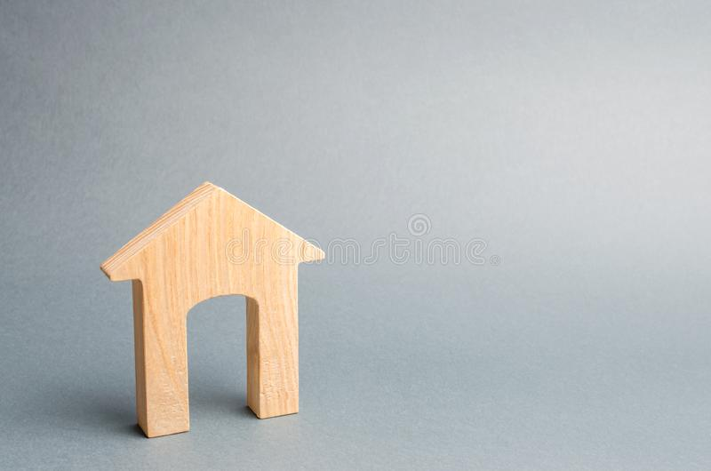 Miniature wooden house on a gray background. Real estate. Long-term rental apartments. Affordable housing for young families. Cheap property loans. Mortgage stock images