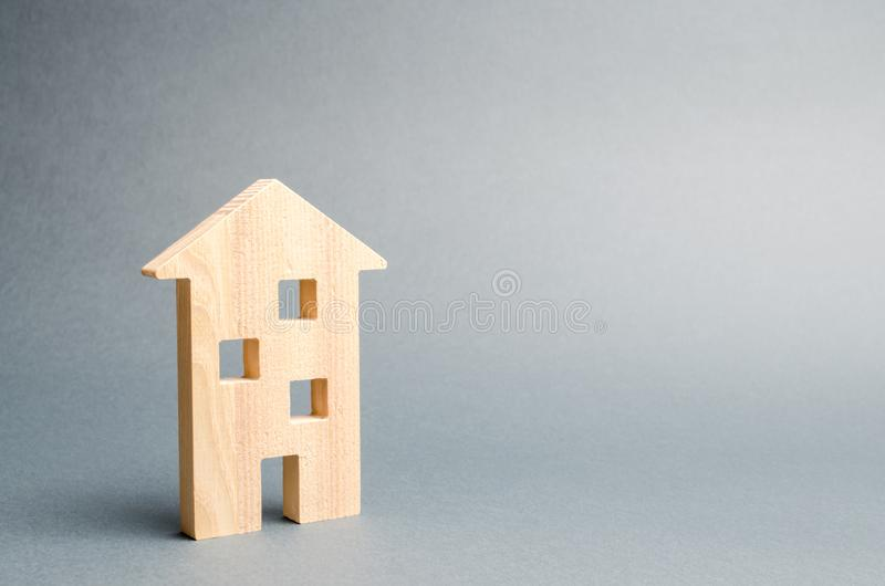 Miniature wooden house on a gray background. Real estate. Long-term rental apartments. Affordable housing for young families. Cheap property loans. Mortgage royalty free stock photo