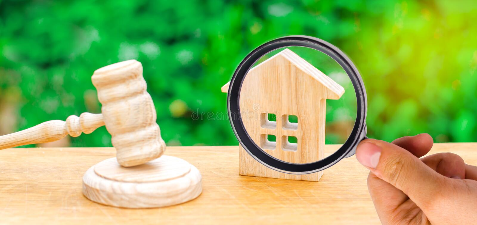 A miniature wooden house and a hammer of the judge. Auction to b royalty free stock image