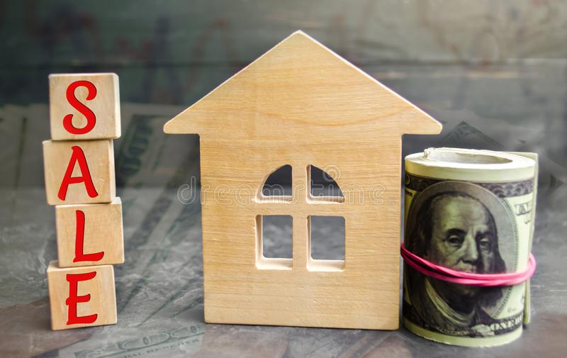 Miniature wooden house and the inscription ` Sale `. real estate concept. sell of a home, apartment property sell. Affordable hous. Ing apartments royalty free stock photo
