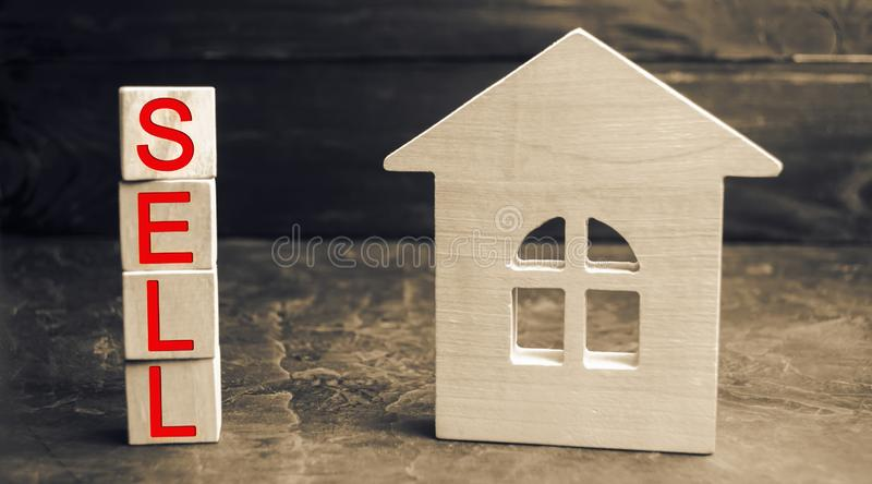 Miniature wooden house and the inscription ` Sell `. real estate concept. sell of a home, apartment property sell. Affordable hous. Ing apartments stock photos