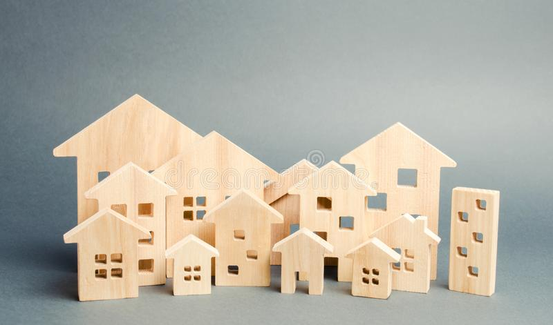 Miniature wooden houses. Real estate. City. Agglomeration and urbanization. Real Estate Market Analytics. Demand for housing. Rising and falling home prices royalty free stock photos