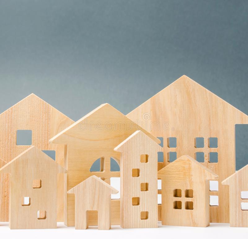 Miniature wooden houses. Real estate. City. Agglomeration and urbanization. Real Estate Market Analytics. Demand for housing. Rising and falling home prices royalty free stock photography