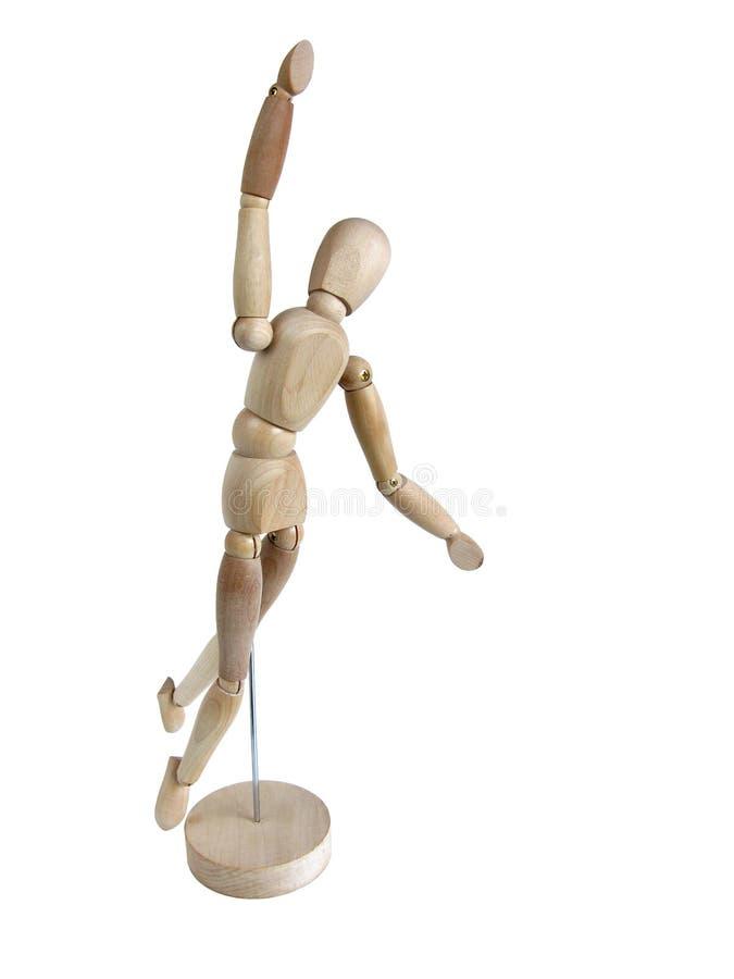Miniature wooden model jumping stock photos