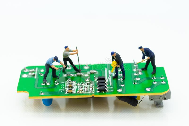 Miniature worker repairing mainboard, clear virus computer and repair, security and technology concept.  royalty free stock photos