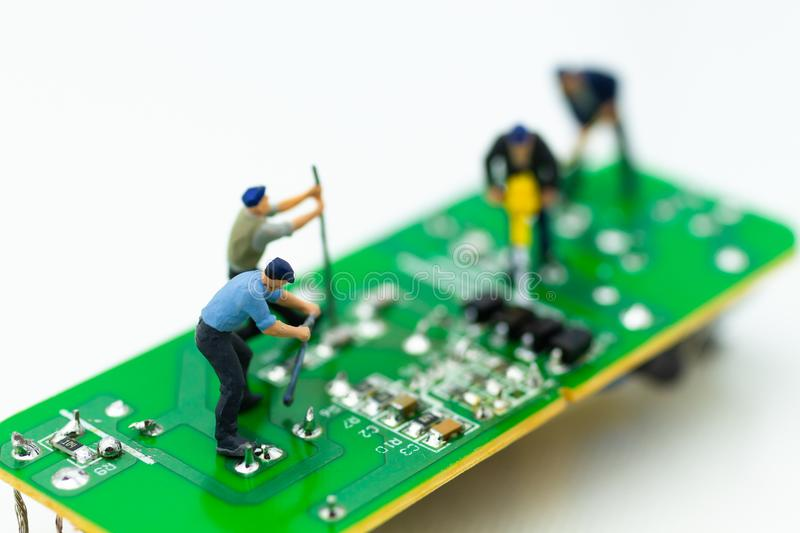 Miniature worker repairing mainboard, clear virus computer and repair, security and technology concept.  royalty free stock photography