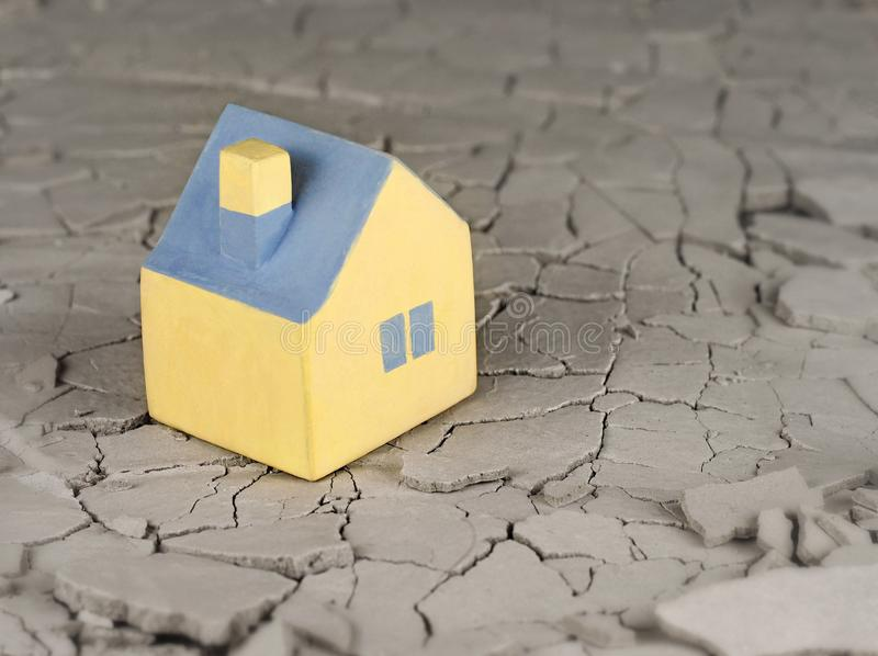Miniature yellow toy house stock photography