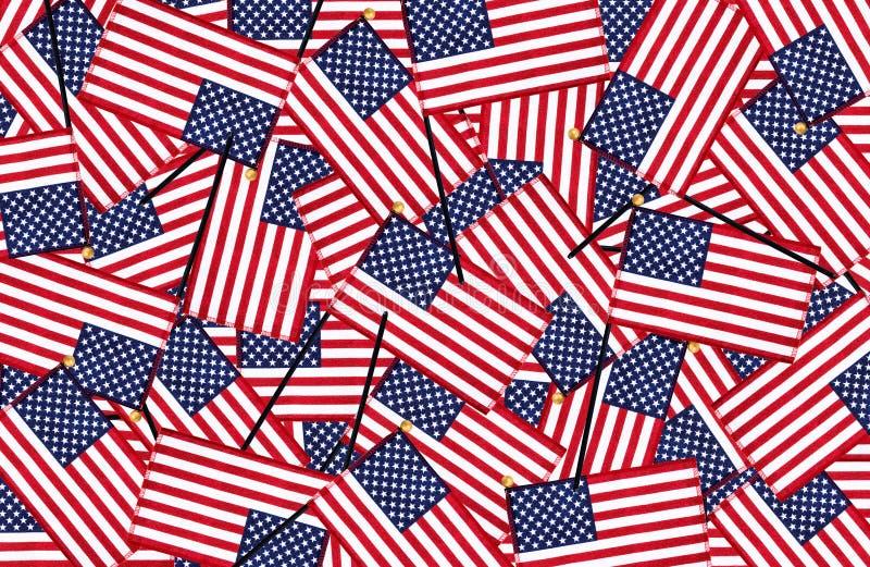Miniaturhintergrund der amerikanischen Flaggen stockfotos