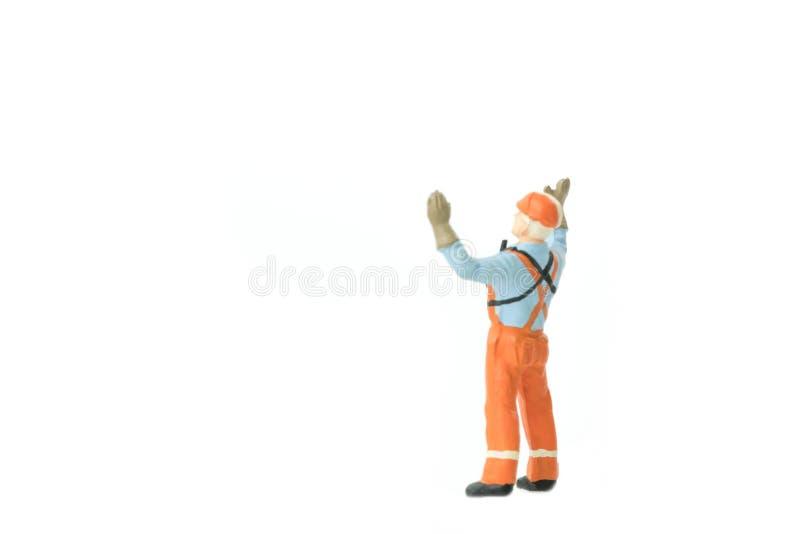 Miniaturleuteingenieurarbeitskraft-Baukonzept lizenzfreies stockbild