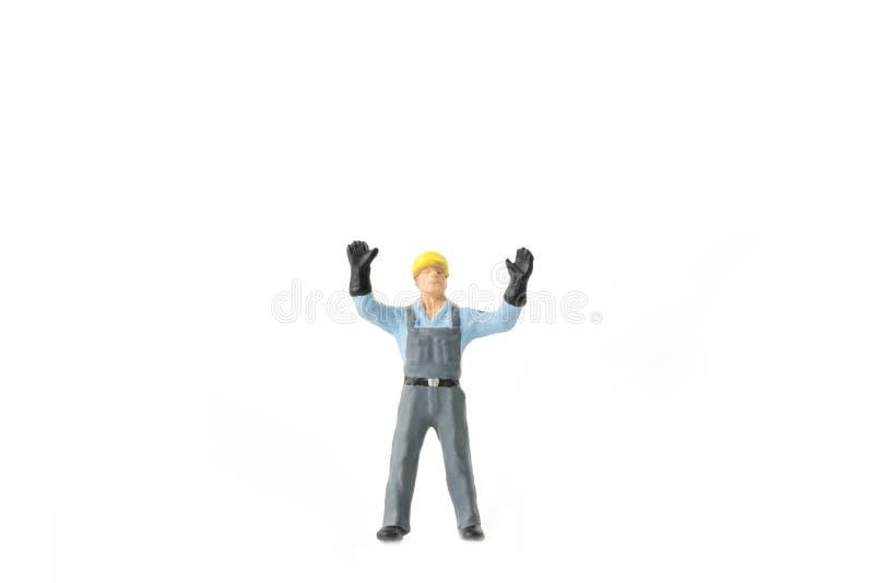 Miniaturleuteingenieurarbeitskraft-Baukonzept stockfotos