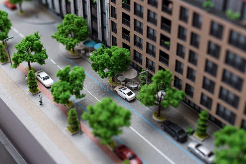 Miniaturowy model, miniatura zabawkarscy budynki, samochody i ludzie, Miasta maquette obraz stock