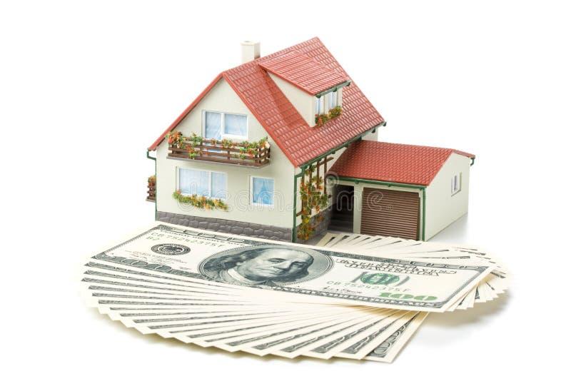 miniaturowy pieniędzy w domu obraz stock
