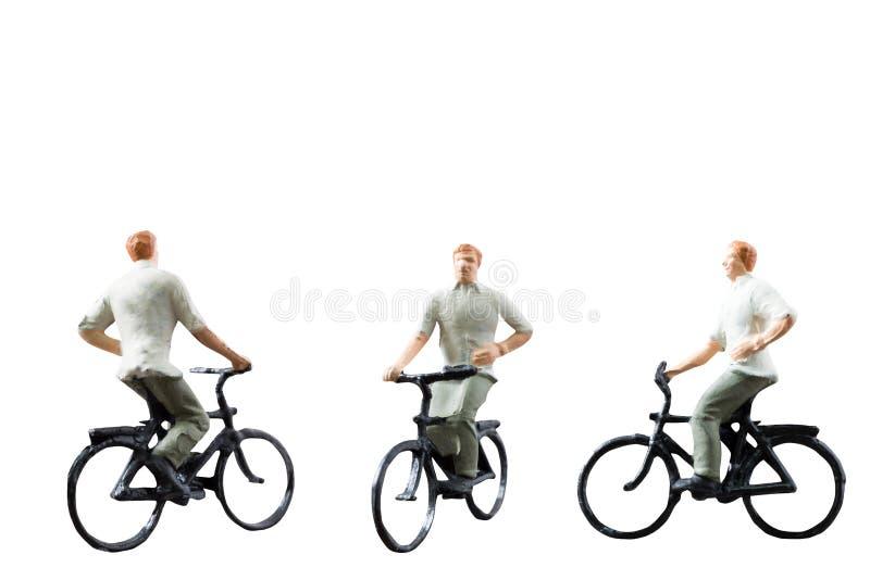 Miniaturowy postaci przejażdżki bicykl odizolowywający na białym tle fotografia royalty free