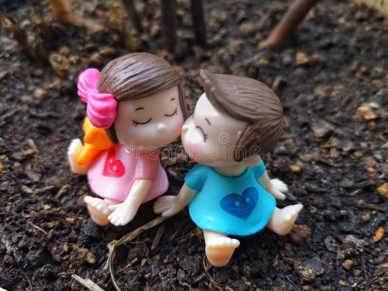 Miniatuur van het kussen van babys met grassenachtergrond royalty-vrije stock foto's