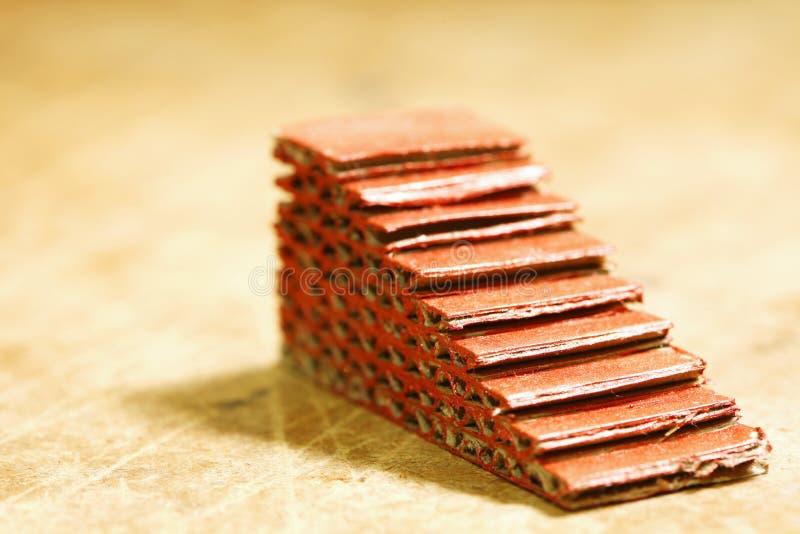 Miniatyr skrapat byggande av trappamomentmodellen royaltyfri fotografi
