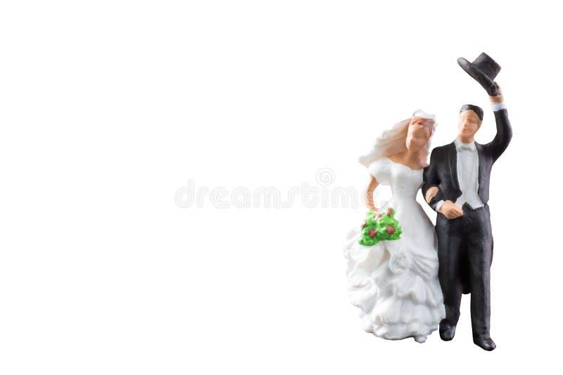 Miniatyrgifta sig för folk som isoleras på vit bakgrund med den snabba banan royaltyfria foton
