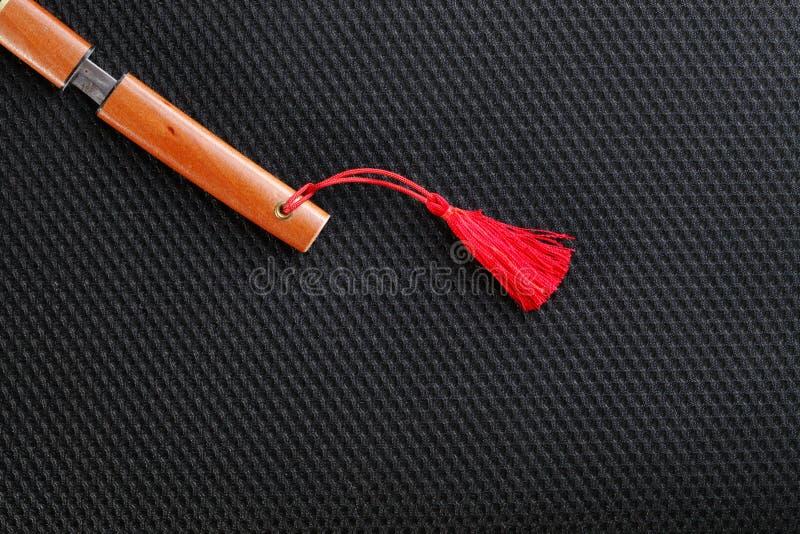 Miniatyrmodellen av det japanska svärdet arkivbild