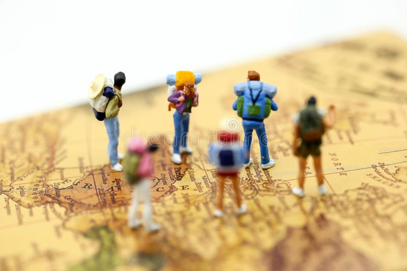 Miniauture people : traveler backpack standing on world map,Travelling concepts. royalty free stock photo