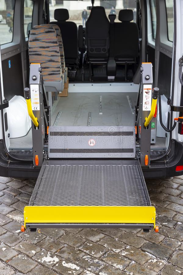 Minibus for physically disabled people. Minibus for handicapped, physically challenged and disabled people in wheelchairs. Minibus with stowed wheelchair ramp royalty free stock image