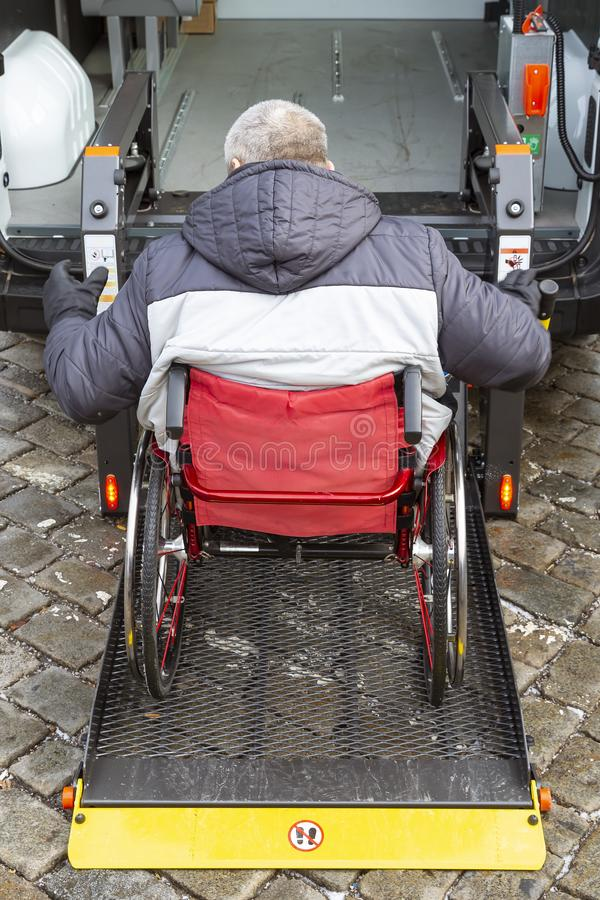Minibus for physically disabled people. Minibus for handicapped, physically challenged and disabled people in wheelchairs. Minibus with stowed wheelchair ramp royalty free stock photo