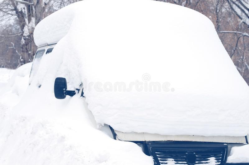 Minibus standing in the Parking lot was covered with snow royalty free stock photo