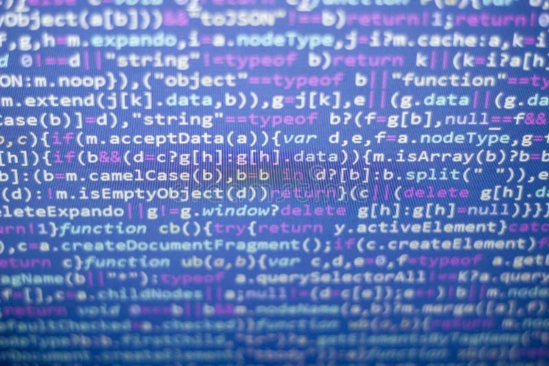 Minificated javascriptkod Dator som programmerar skärmen för abstrakt begrepp för källkod av rengöringsdukbärare arkivfoto