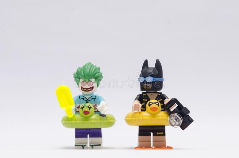 Lego vacation joker and batman minifigures isolated on white background royalty free stock image