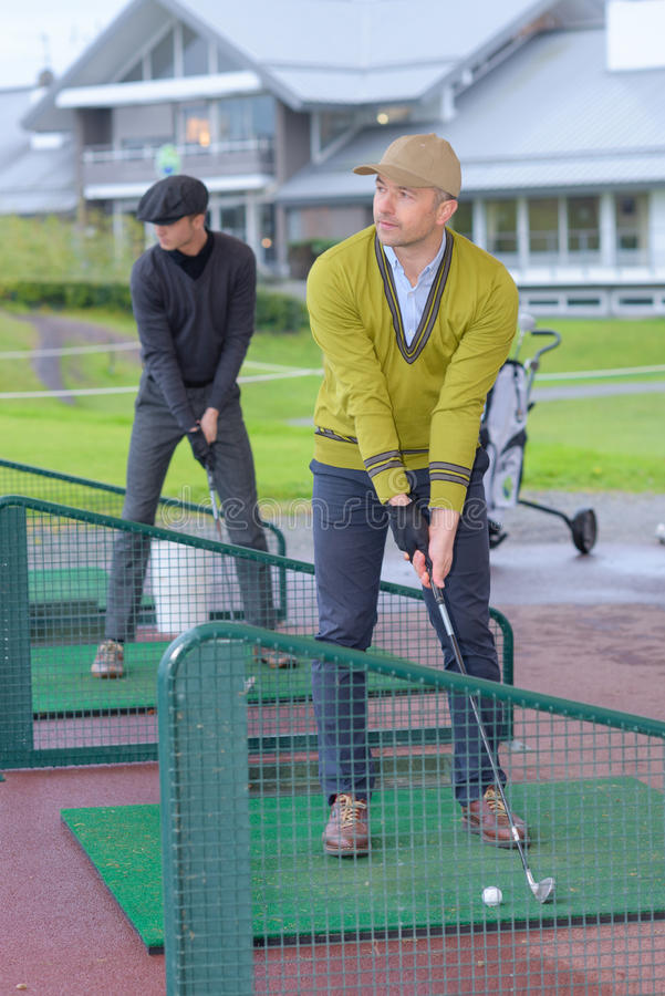 Minigolf player searchs for best start position stock photography