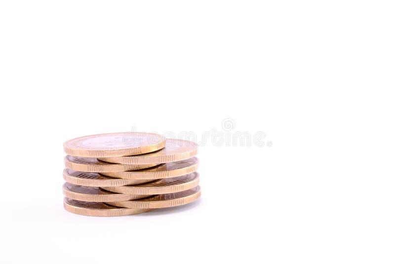 Minimünzenturm lokalisiert auf einem Weiß stockfotografie