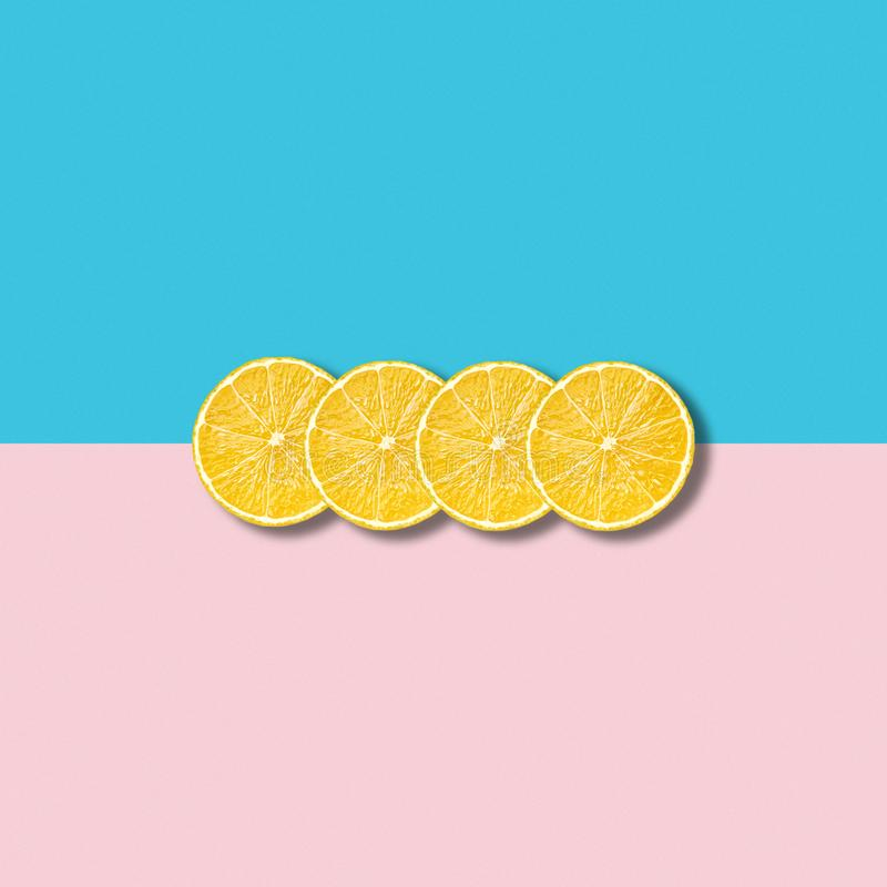 Minimal abstract illustration with group of lemon slices on pastel background stock images